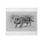 Lion Cub Stalking Throw Blanket