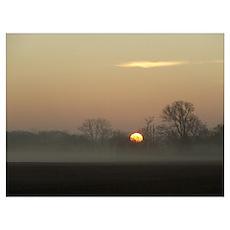 Sunrise over fog Poster
