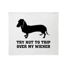 Try not to trip over my wiener Throw Blanket