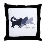 Running Huskies Throw Pillow