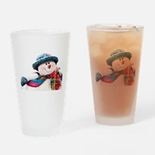 Cute winter snowman with blue hat Drinking Glass