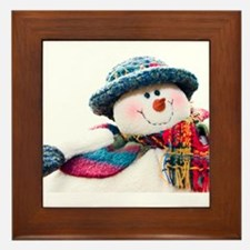 Cute winter snowman with blue hat Framed Tile