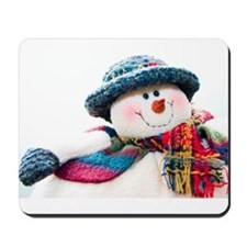 Cute winter snowman with blue hat Mousepad