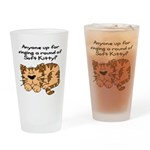Singing a round of Soft Kitty Drinking Glass