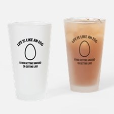 Life is like an egg Drinking Glass