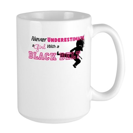 Never underestimate a girl with a black belt Mugs