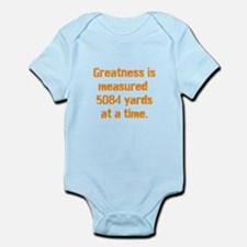 Greatness is measured 5084 ya Infant Bodysuit