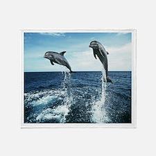 Dolphins In The Ocean Throw Blanket