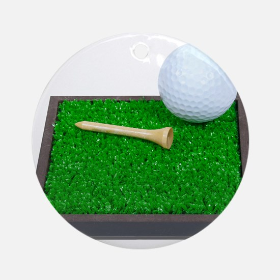 Golf Ball Tee Laying on Grass Ornament (Round)