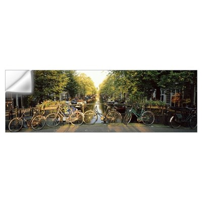 Netherlands, Amsterdam, bicycles on bridge over ca Wall Decal