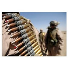 Belts of 50caliber ammunition hang from the should