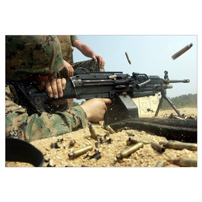 A Marine engages targets with an M249 Squad Automa Framed Print
