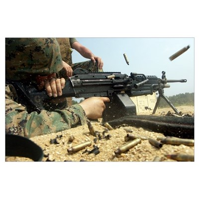 A Marine engages targets with an M249 Squad Automa Poster