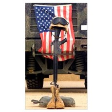 An M16A2 service rifle a pair of boots and a helme Framed Print