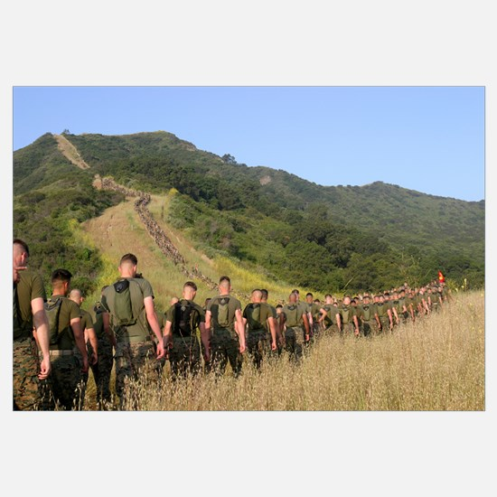Marines hike their way to a memorial site set up j