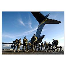 Soldiers prepare to board a C17 Globemaster III Poster