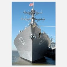 The guided missile destroyer USS Cole sits moored