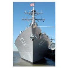 The guided missile destroyer USS Cole sits moored  Poster