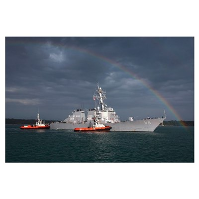 A rainbow arches over the guided missile destroyer Framed Print
