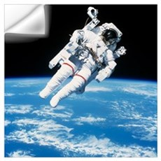 Astronaut floating in space Wall Decal