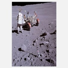 An astronaut and a lunar roving vehicle during an