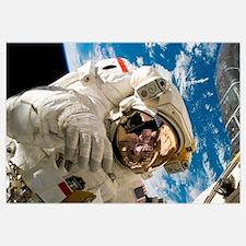 An astronaut mission specialist participates in ex