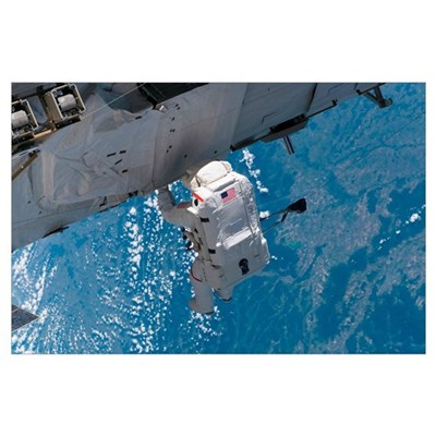 Astronaut traverses along the station hardware on Poster