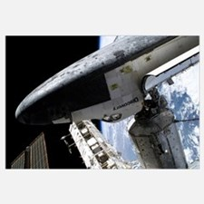 Space Shuttle Discovery docked to the Internationa