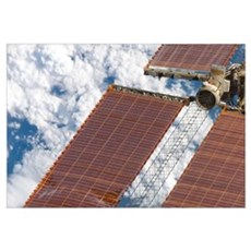 A repaired solar array on the International Space  Framed Print