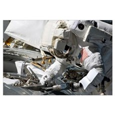 Astronaut participates in extravehicular activity Framed Print