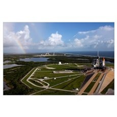 Space shuttle Atlantis and Endeavour on launch pad Poster