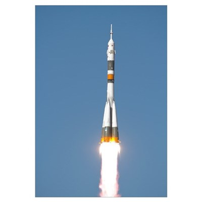The Soyuz TMA12 spacecraft lifts off into a cloudl Framed Print