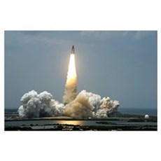 Space Shuttle Atlantis lifts off into the sky Poster