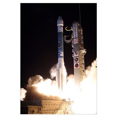 A United Launch Alliance Delta II rocket lifts off Framed Print