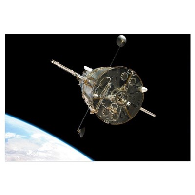 The Hubble Space Telescope in orbit above Earth Framed Print