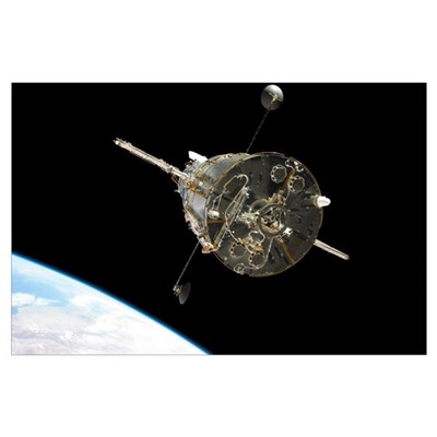 The Hubble Space Telescope in orbit above Earth Poster