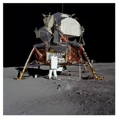 An Apollo 11 astronaut in front of the lunar modul Framed Print