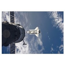 Space Shuttle Atlantis and a Russian spacecraft ba