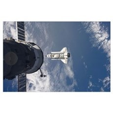 Space Shuttle Atlantis and a Russian spacecraft ba Poster