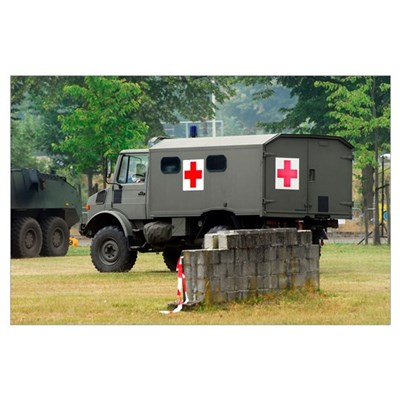 A Unimog in an ambulance version in use by the Bel Poster
