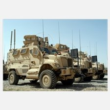 Mine Resistant Ambush Protected vehicles sit in pa