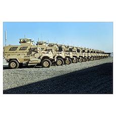 Mine Resistant Ambush Protected vehicles sit at Ca Poster