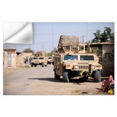 Humvees conduct security during a patrol in the vi Wall Decal