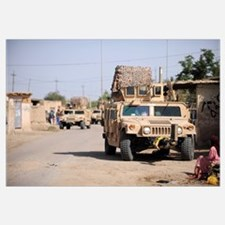 Humvees conduct security during a patrol in the vi