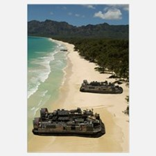 US Navy Landing Craft land on the beach to offload