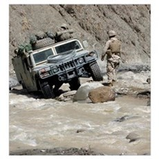 A US Marine guiding a Humvee through a river in Kh Poster