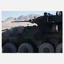 A light armored vehicle fires its 25mm Bushmaster