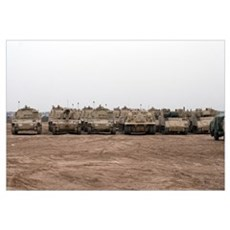 A selection of M992 CAT vehicles line up during a  Framed Print