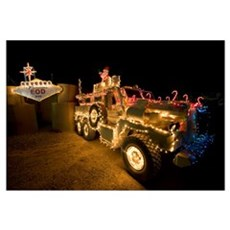 Cougar MRAP is adorned in holiday lights parked in Framed Print