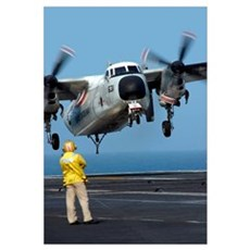 A US Navy officer observes a C2A Greyhound aircraf Canvas Art
